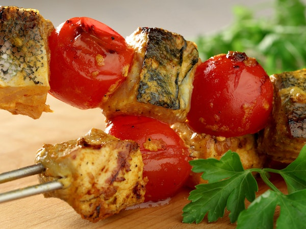 Mahi-mahi kebabs are marinated in a spicy mixture before being grilled along with fresh tomatoes.