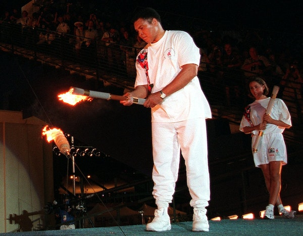 American swimmer Janet Evans looked on as boxing legend Muhammad Ali capivated the nation and the world when he lit the Olympic flame before the 1996