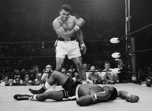 FILE - In this May 25, 1965, file photo, heavyweight champion Muhammad Ali stands over fallen challenger Sonny Liston, shouting and gesturing shortly
