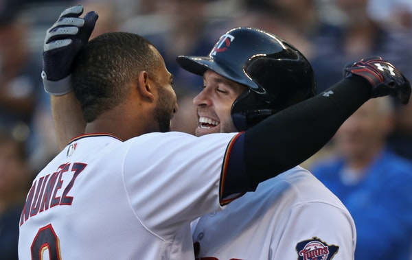 Eduardo Nunez(9) hit an inside the park HR in the first inning gets greeted by Brian Dozier(2).] At Target Field in a game between the Tampa Bay Rays