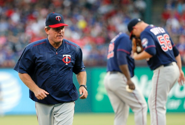 Minnesota Twins pitching coach Neil Allen jogs back to the dugout after paying starting pitcher Tyler Duffey a visit on the mound in the first inning