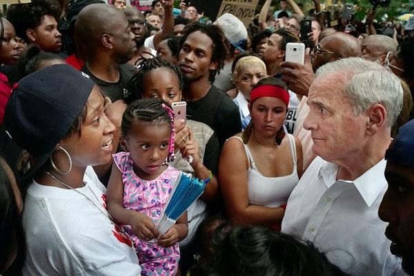 Governor Mark Dayton met with family members including Diamond Reynolds and her daughter, far left.