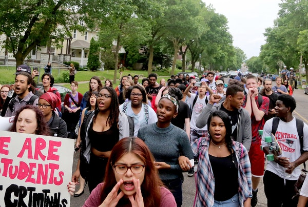 St. Paul Central students marching down Marshall Avenue toward City Hall on Tuesday will receive unexcused absences.