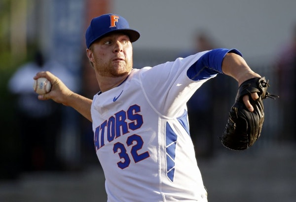 Florida pitcher Logan Shore throws against Florida A&M during the first inning of an NCAA college baseball tournament regional game Friday, May 29, 20