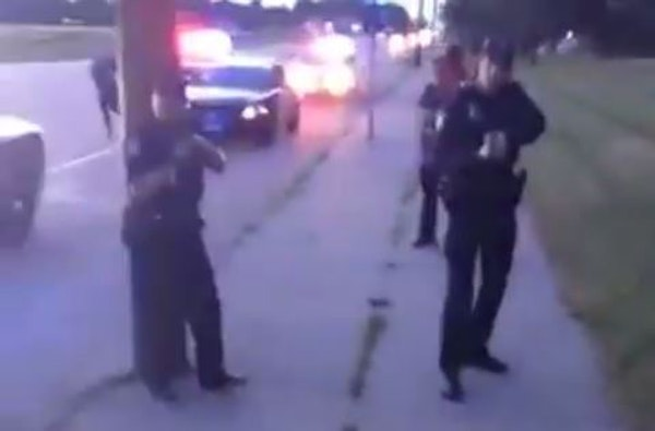 In a scene from the video of the Falcon Heights shooting aftermath, the woman filming exits the car under orders from police.
