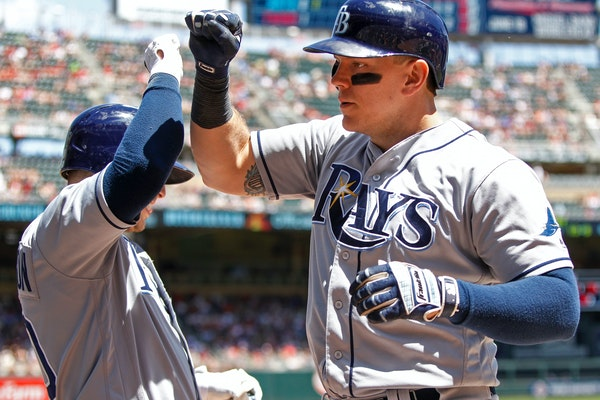 The Rays' Logan Morrison, right, celebrated with Corey Dickerson after his second-inning home run against the Twins on Sunday.