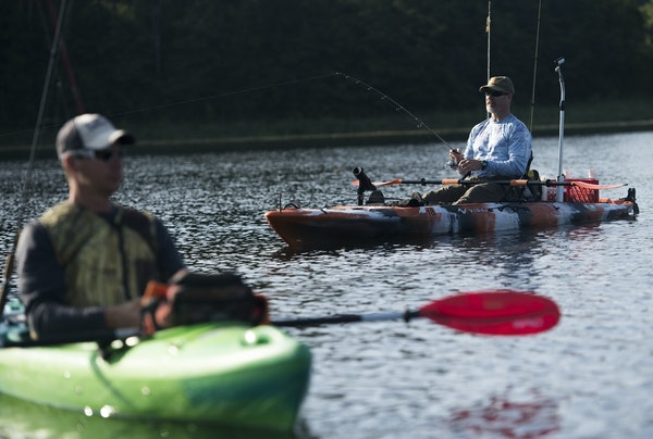 Anglers KP Enderle, right, tested the waters with his line along with Pat Caldwell on a recent morning near Prior Lake. Kayaks for fishing generally h