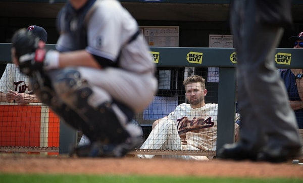 Brian Dozier watched the 9th inning from the dugout.