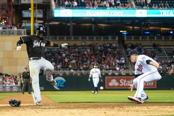 Miami Marlins shortstop Adeiny Hechavarria (3) scored after a wild pitch by Minnesota Twins relief pitcher Trevor May (65) in the top of the 7th innin