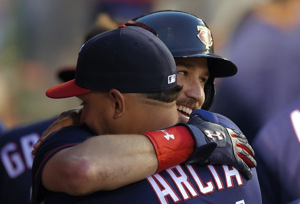 The Twins' Trevor Plouffe was congratulated by Oswaldo Arcia after hitting a three-run homer during the third inning against the Angels on Monday ni