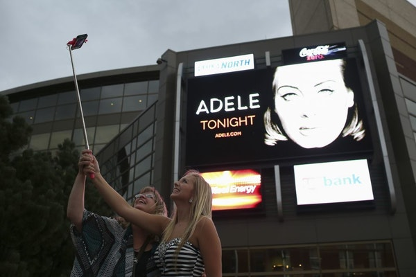 Susan Daugherty and her daughter, Sarah, of Superior, Wis., arrived at Xcel Energy Center on Tuesday for Adele's concert well before the rain did.