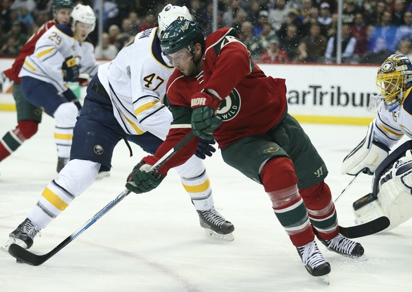 Wild left winger Thomas Vanek got off a backhand while defended by the Sabres' Zach Bogosian (47) in the first period Tuesday.