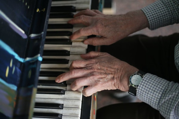 """Gerald Ollila, 80, played a piano outside of the IDS Center on Wednesday. Ollila but used to play 40 years ago, but """"never learned music, notes, or an"""
