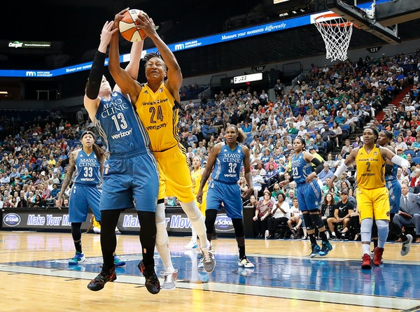 Lindsay Whalen (13) and Tamika Catchings (24) fought for a loose ball in the third quarter.