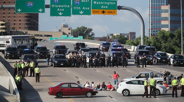 Protesters used vehicles and their bodies to block the southbound lanes of I-35W near the U on Wednesday, July 13, 2016 in Minneapolis. The shutdown l
