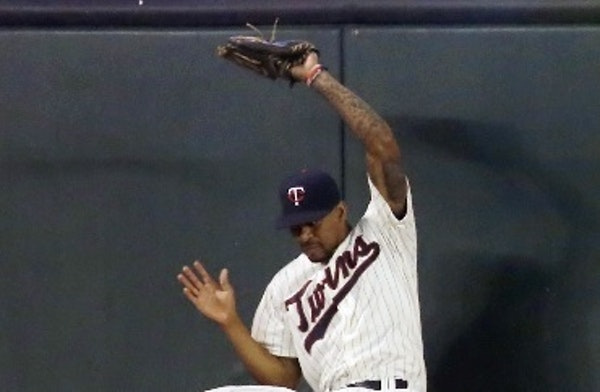 Twins center fielder Byron Buxton went up against the wall to rob the Phillies' Tyler Goeddel of a hit during a June 22 game.