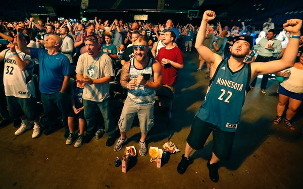Joshua Hill, 34, (right) of Minneapolis celebrated after the Timberwolves selected Kris Dunn with 5th pick of the draft.
