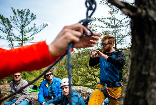 Christian Fraser, a Vertical Endeavors instructor and guide, discussed techniques with other experienced rock climbers for teaching a Munter Mule knot