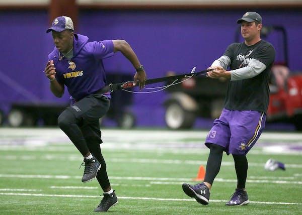 Minnesota Vikings quarterback Teddy Bridgewater, left, and Shaun Hill ran through drills during a player offseason workout at Winter Park, Tuesday, Ap