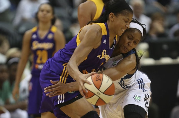 Maya Moore tried to steal the ball away from L.A. star Candace Parker in 2013.