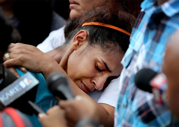Lashea Jones, the mother of a 2-year old who was shot and killed in north Minneapolis, weeps during a vigil Friday in Minneapolis.