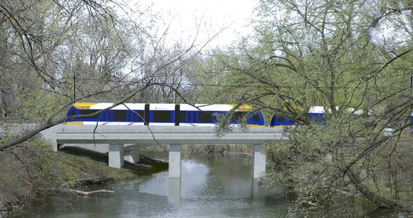 A rendering of the Southwest light rail train passing through the Kenilworth Lagoon. The train line aiming to link Eden Prairie to Minneapolis is a st