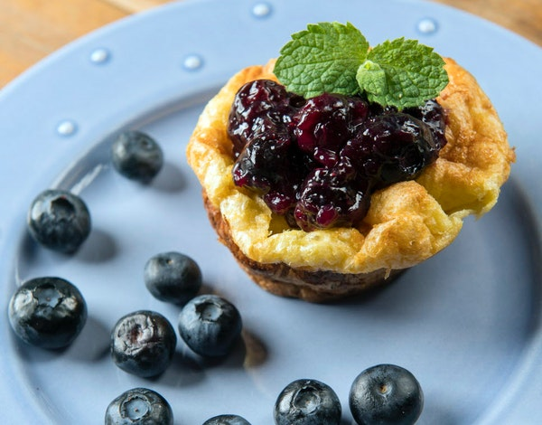 Finished Dutch Puff with blueberry compote, blueberries, and basil.