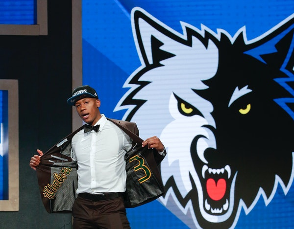Kris Dunn reacts as he steps up on stage after being selected fifth overall by the Minnesota Timberwolves during the NBA basketball draft, Thursday, J