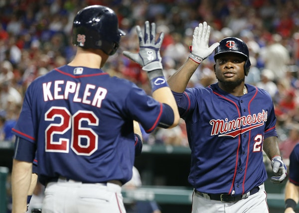Minnesota Twins' Miguel Sano (22) celebrates his three-run home run with Max Kepler (26) against the Texas Rangers during the fifth inning of a baseba