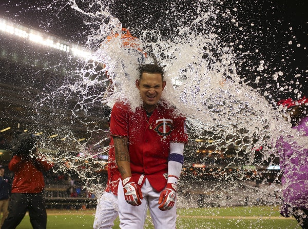 Twins' Oswaldo Arcia received a Gatorade shower just before he was going to do a post-game interview after his walk off home run gave the Twins a vict