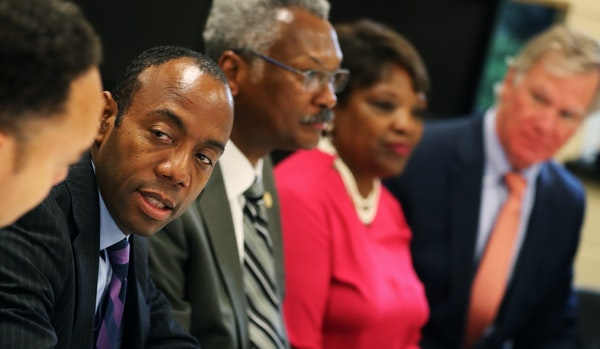 NAACP President Cornell Brooks,left, was present in a closed door meeting].]At the Progressive Baptist Church in St. Paul, Governor Mark Dayton and NA