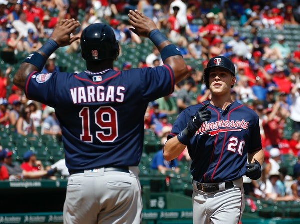 The Twins' Max Kepler celebrated his grand slam with Kennys Vargas as he arrived home against the Rangers during the fifth inning Sunday.