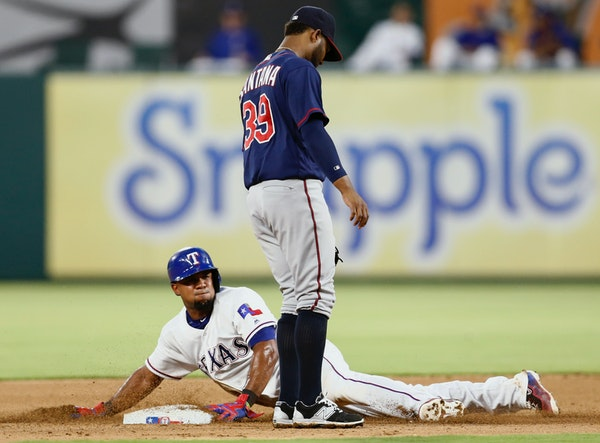 Texas Rangers' Elvis Andrus steals second base in front of Minnesota Twins shortstop Danny Santana (39) during the fourth inning of a baseball game, F