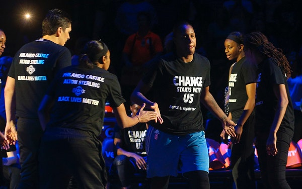 Minnesota Lynx forward Rebekkah Brunson (32) walks out to the court as starting lineups are announced.