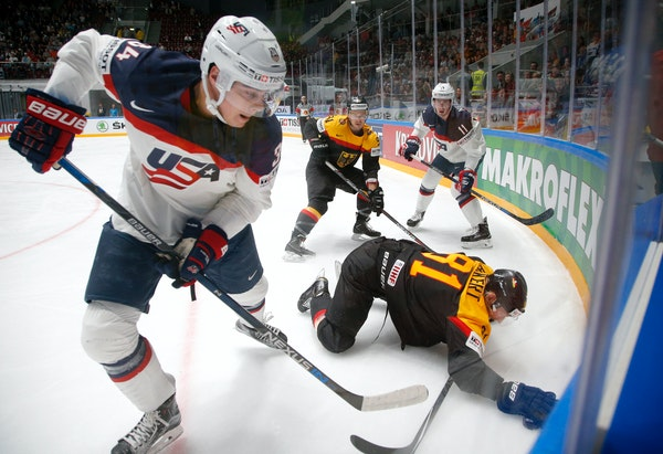 In this May 15, 2016 file photo, the United States' Auston Matthews, left, fought for the puck with Germany's Torsten Ankert during a Hockey World Cha