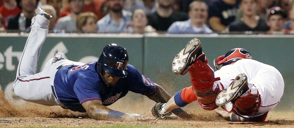 Boston catcher Sandy Leon failed to put the tag on Kennys Vargas at home plate in the seventh inning. Plate umpire Clint Fagan called Vargas out, but