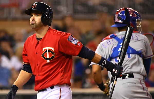 Brian Dozier carried his bat back to the dugout after striking out against hard-throwing Texas reliever Matt Bush. Dozier went 1-for-4 with a single,