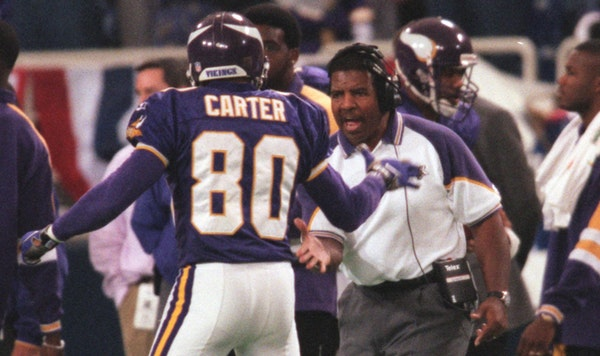 Dennis Green and Cris Carter in the 1990s.