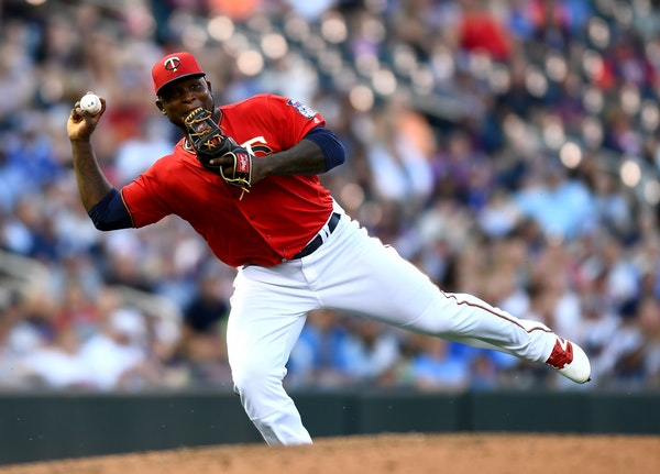 Minnesota Twins third baseman Miguel Sano (22) committed a throwing error to first after a single was hit his way by Cleveland Indians first baseman M