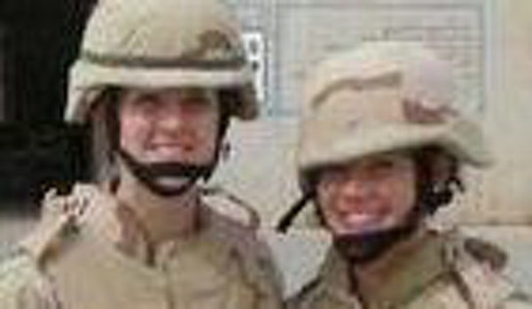 Julie Tomaska, left, and Amie Muller at the U.S. Air Base in Balad. Both report health problems.
