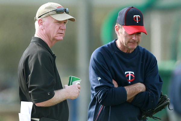 Minnesota Twins general manager Terry Ryan chats with manager Paul Molitor