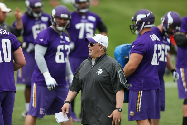 Vikings offensive line coach Tony Sparino worked with the line during OTA training at Winter Park in June.