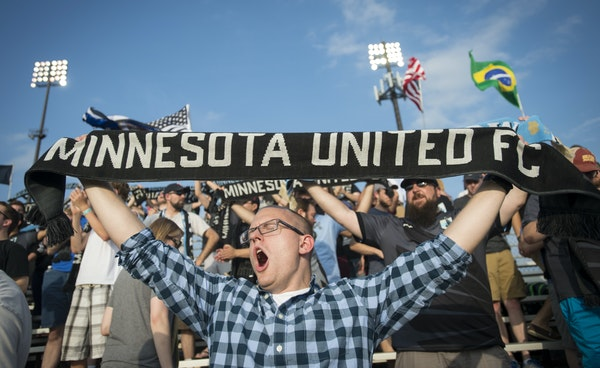 Longtime Dark Clouds member David Martin of Prior Lake waved his Minnesota United FC scarf as he exhorted the Loons on Wednesday night.