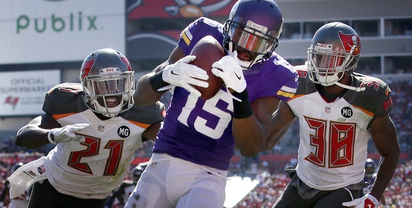 Greg Jennings (15) caught a 17-yard touchdown pass while being defended by Alterraun Verner (21) Dashon Goldson (38) in the third quarter. ] - October