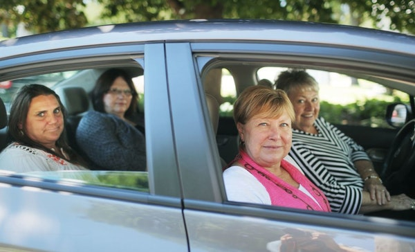 Four mothers with sons in the Minnesota Security Hospital in St. Peter prepare to embark to St. Peter for a one of their regular meetings to advocate