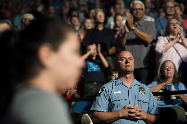 Minneapolis police officer Michael Osbeck looked towards the court as the Lynx's starting lineup is announced.