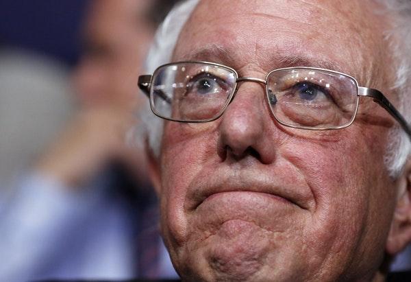 Former Democratic presidential candidate, Sen. Bernie Sanders, I-Vt., waits before asking that Hillary Clinton become the unanimous choice for Preside