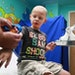 Tommy Boegler, 4, of Tamarac, Fla. with MEDi at his side during a visit to Broward Health. The hospital is one of eight hospitals nationwide using a c