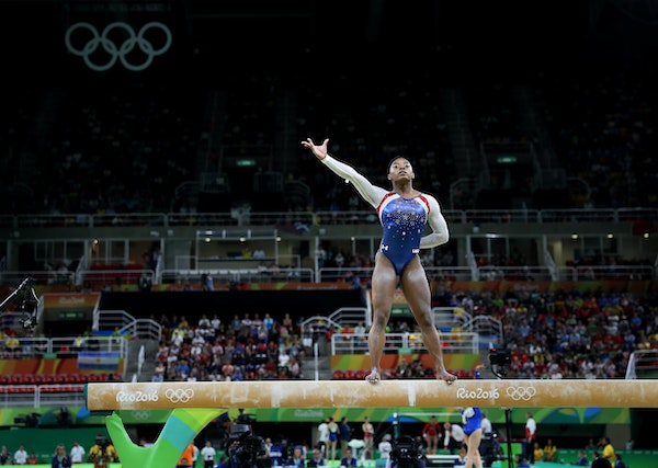 USA's Simone Biles won the all-around title in women's gymnastics and her teammate Aly Raisman took home the silver.