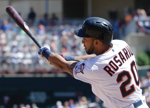 Minnesota Twins' Eddie Rosario hits into an RBI fielder's choice off Texas Rangers relief pitcher Tony Barnette in the fifth inning of a baseball game